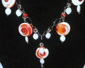 Long Beaded Necklace featuring round Operculum Shell Charms made of orange resin-filled shells, Garbo Style, White Metal Chain, Gift for her