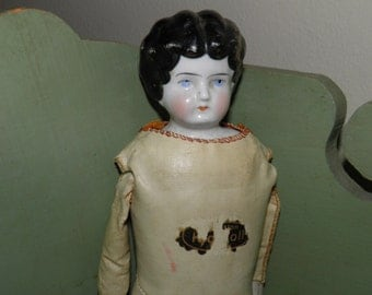 Antique Porcelain Head Leather Body Doll