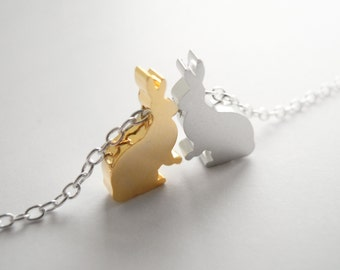 Silver bracelet with two tiny rabbit pendants