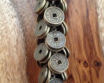 """the """"feng shui"""" asian small coin keychain"""