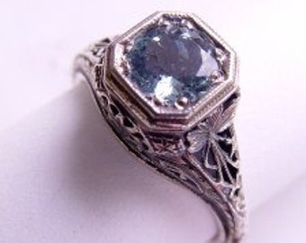 Detailed floral filigree setting and 6mm sapphire set in sterling silver