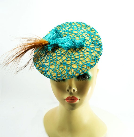 Golden Sinamay Saucer/ Headpiece covered with Turquoise Fishnet Fabric