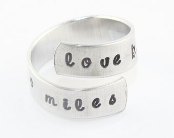 SALE - Love Knows No Miles Wrap Ring - Adjustable Twist Aluminum Ring - Handstamped Ring - Graduation Present - Valentine's Day