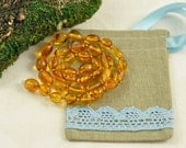 Baltic Amber Baby teething necklace Honey cognac, polished, BIG olive beads in Lovely Linen gift bag