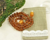 Baltic Amber Baby teething necklace cognac, unpolished, baroque beads in Lovely Linen gift bag