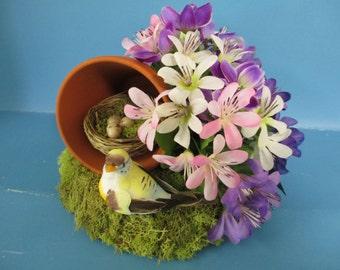 floral arrangement Birdsnest in a flowerpot flower arrangement with bird and eggs