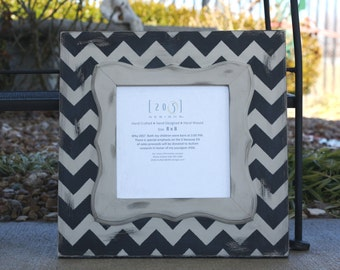 Distressed Frame in 8x8 Chevron.  Colors are Black and Frappe.