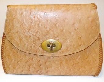 Elegant ostrich handbag with brass turnlock closure