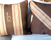 These 18X18 pillows are mostly brown cotton with handstiched burlap trim on the front and dark rusty red cotton piping.
