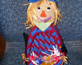 Cute little scarecrow candy holder .