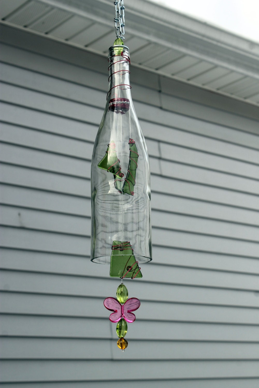 Wine bottle wind chime with green slumped glass for Glass bottle wind chimes
