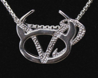 21 Taurus and Capricorn Silver Unity Pendant