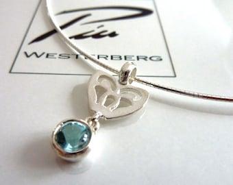 Silver necklace with sky blue topaz