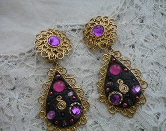 Earrings 1980's Rubber and glass clip ons