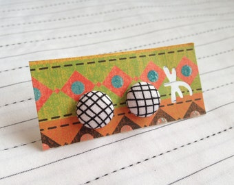 Fabric covered button earrings.