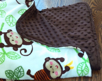 Large double sided minkie blanket with monkey's.