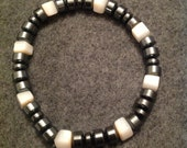 Hematite and stone beads. Fits most wrists. (Men)