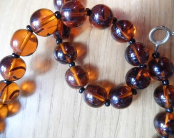 A striking Vintage Czech Amber glass beaded necklace.