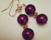 Beautiful and rich plum purple colored pearl bead and gold accent drop earrings