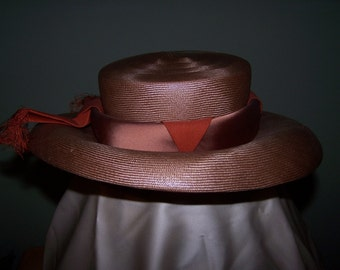 Toast colored, low top, wide brim Hat