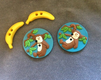 "Monkey buttons. Rubber monkey buttons w/ bananas 1"" (25mm). 2 monkeys, 2 bananas"
