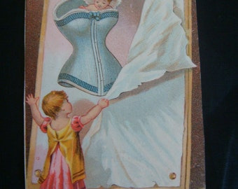 TREASURY Item~AwEsOmE AnTiQuE TrAdEcArD Dr. Warners CoRaLiNe CoRsEt with AnGeL /CoRsEtS on BoTh SiDeS