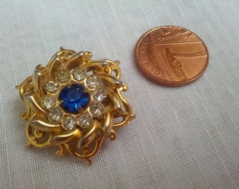Gold Tone Tiered Flower Shaped Brooch with Blue and Clear Rhinestones