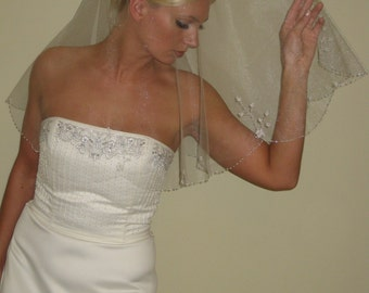 "Hand beaded wedding veil fingertip length circular cut 42"" long."