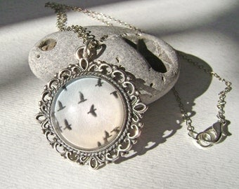Vintage pendant flying bird . Vintage pendant .