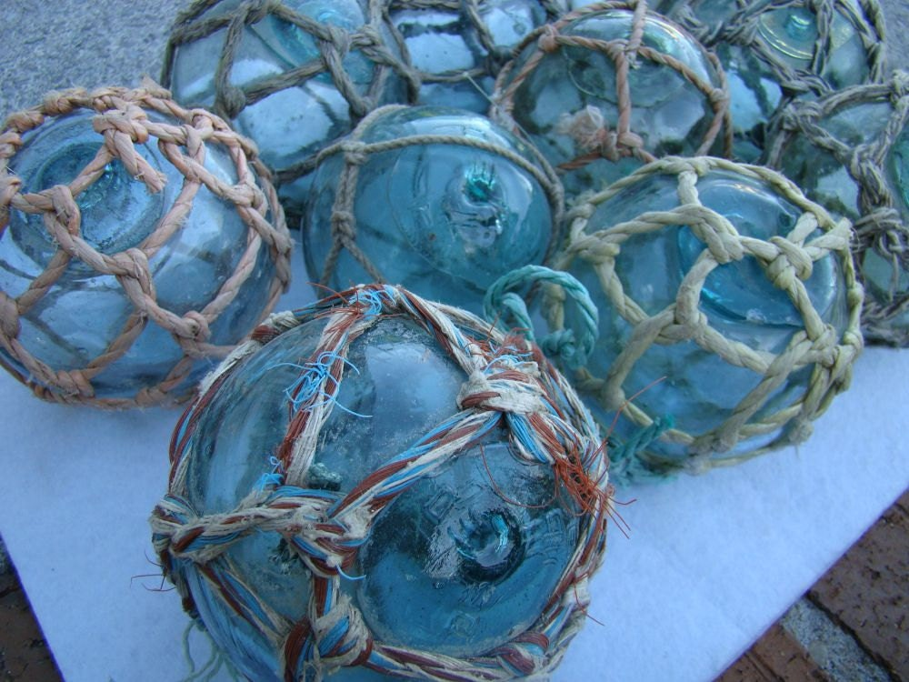 3 japanese glass fishing floats with netting old