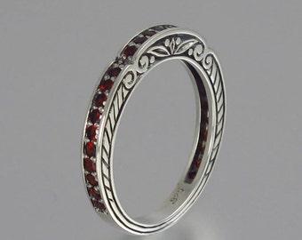 CARYATID wedding band in sterling silver with Garnet