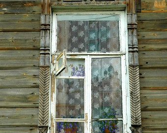 Decorative Russian Window Photography. Woodwork. Dacha, cabin. Ancient architecture. Raw wood. Onion dome reflection. Russia.