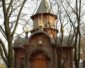 Wooden Chapel. Ancient Architecture. Gold Onion Dome Church. Trees, branches. Moscow, Russia.