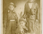 VERY RARE 1910s Real Photo Postcard (RPPC) of Three Children as Cowboy, Cowgirl, and Indian Fancy Dress, Costume, Halloween, Souvenir