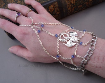 Dragon handflower chain slave bracelet, bright silver tone, sapphire blue Swarovski crystal, adjustable toggle clasp, fantasy ring bracelet