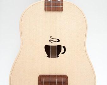 Ukulele (customizable sound hole of choice) Example: coffee cup