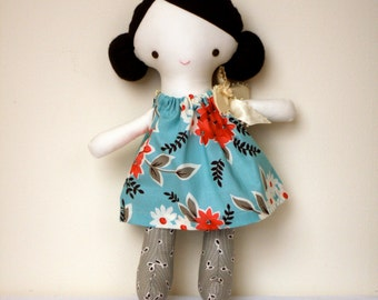 Florence doll- dark brown hair, green eyes