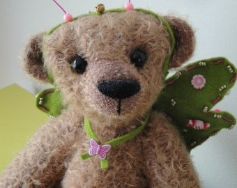 Mary, butterfly bear with green wings