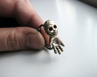 Skully the sideways skeleton ring