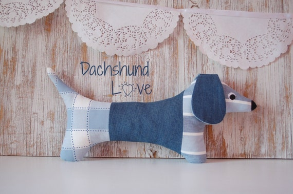 Eco-friendly stuffed sausage dog, made with upcycled materials