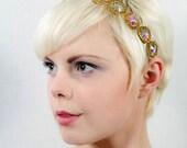 golden headband with iridescent jewels