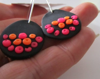 pink and orange dot, black blob and silver wire polymer clay earrings
