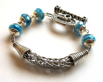 Bracelet  - Hand-Crafted Asymmetrical Viking Knit in Silver with Blue Faceted Beads