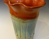 Altered terracotta vase with sea foam and golden brown glaze