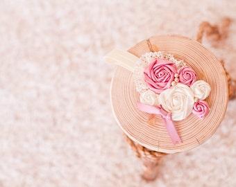 Lovely vintage inspired ivory and pink rosettes on ivory elastic headband
