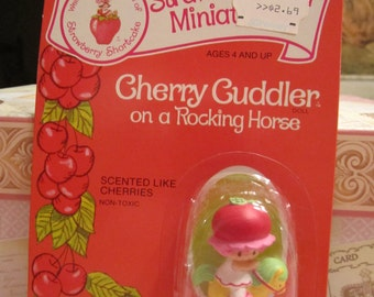 Vintage 1982 Strawberry Shortcake American Greetings PVC Plastic Doll Miniatures NEW Cherry Cuddler On A Rocking Horse