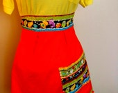 Monster Apron orange with multi colored pattern