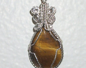Tigereye teardrop Pendant, wire wrapped in twisted Silverfilled wire