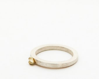 silver ring with golden drop