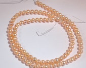 AA Peach Pearls, 4-5mm Pink Near Round Freshwater Pearls--3.5 inch strand